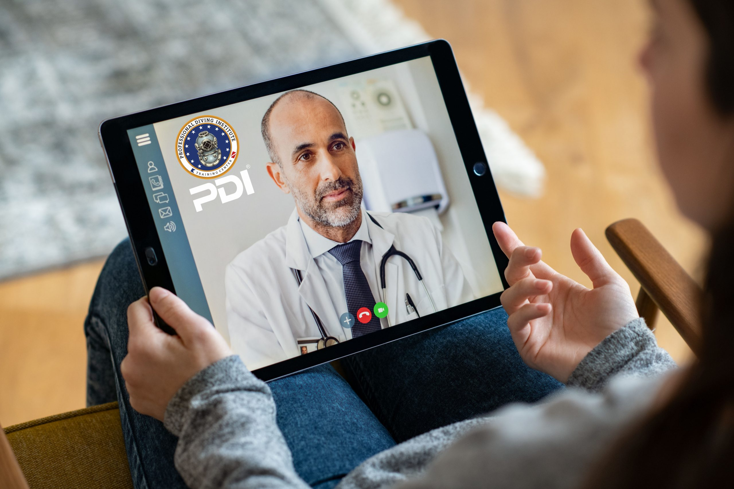 Back view of young woman making video call with her doctor while staying at home. Close up of patient sitting on armchair video conferencing with general practitioner on digital tablet. Sick girl in online consultation with a mature physician.